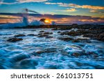 waves and rocks at sunset  at... | Shutterstock . vector #261013751