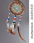 Small photo of Tight shot of beaded Native american dream catcher on gray background.