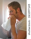 Small photo of Airsickness. Man feels very bad on the plane.