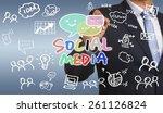 businessman hand drawing social ... | Shutterstock . vector #261126824