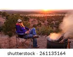blond woman sitting by campfire ... | Shutterstock . vector #261135164