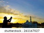 muslim kid prayed during sunset  | Shutterstock . vector #261167027