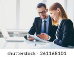 man explaining something to his ... | Shutterstock . vector #261168101