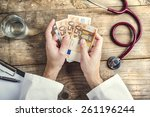 hands of unrecognizable doctor... | Shutterstock . vector #261196244