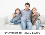 family sitting on the couch... | Shutterstock . vector #261216299