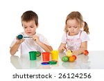 Little girl and boy painting the easter eggs with paintbrushes - isolated - stock photo