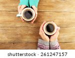 female hands holding cups of... | Shutterstock . vector #261247157