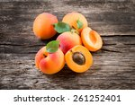 Apricot With Leaves On Wooden...
