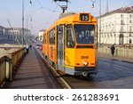 Small photo of TURIN, ITALY - JANUARY 11, 2013: Tram on the bridge. Such trams are intended for movement on narrow streets of historical part of city