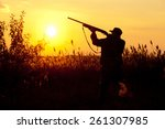 rifle hunter silhouetted in... | Shutterstock . vector #261307985