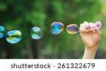 A Man Blowing Soap Bubbles