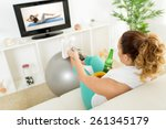 lazy woman in sport clothing... | Shutterstock . vector #261345179
