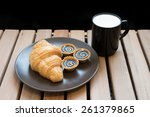croissant and milk. | Shutterstock . vector #261379865