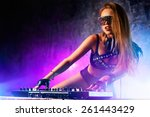 young sexy woman dj playing... | Shutterstock . vector #261443429