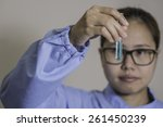 young female asian lab worker... | Shutterstock . vector #261450239