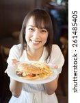 young woman eating hamburger at ...   Shutterstock . vector #261485405