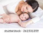 happy family. mother and baby | Shutterstock . vector #261531359