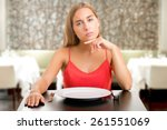 hungry woman on a diet waiting... | Shutterstock . vector #261551069