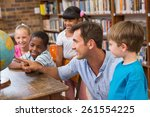 cute pupils and teacher looking ... | Shutterstock . vector #261554225