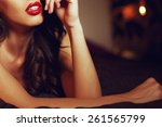 sexy woman with red lips on bed ... | Shutterstock . vector #261565799