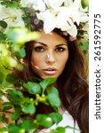 young beautiful woman in wreath ... | Shutterstock . vector #261592775