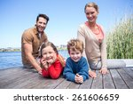 happy family at a lake in the... | Shutterstock . vector #261606659