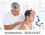 doctor doing neck adjustment in ... | Shutterstock . vector #261614267