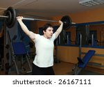 young bodybuilder in a gym at... | Shutterstock . vector #26167111