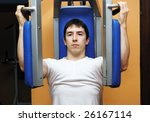 young bodybuilder in a gym at... | Shutterstock . vector #26167114