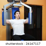young bodybuilder in a gym at... | Shutterstock . vector #26167117