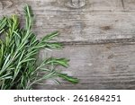 rosemary on a wooden background | Shutterstock . vector #261684251