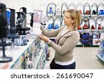 woman chooses a blender in the... | Shutterstock . vector #261690047