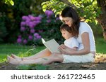 Mother And Boy  Reading A Book...