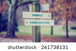 Stock photo rustic wooden sign in an autumn park with the words simple complicated offering a choice of 261738131