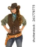 a cowgirl with her hands on her ... | Shutterstock . vector #261778775