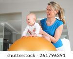 A Physiotherapy With Baby On A...
