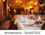 glasses of wine on a table in a ... | Shutterstock . vector #261827321