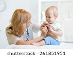 Female Doctor Examining Child...