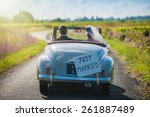 a newlywed couple is driving a... | Shutterstock . vector #261887489