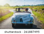 a newlywed couple is driving a... | Shutterstock . vector #261887495