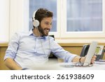 Cheerful Man Listening Music...