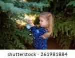 baby girl in spring park... | Shutterstock . vector #261981884