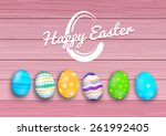 easter colored eggs on rustic... | Shutterstock .eps vector #261992405
