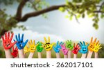 Colorful Painted Hands In Fron...