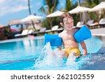 happy boy in swimming armbands... | Shutterstock . vector #262102559
