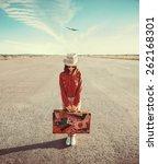 woman traveler holds vintage... | Shutterstock . vector #262168301