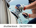 Winch And Sailors Hands On A...