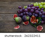 Ripe Grapes And Figs On Dark...