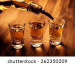 Three Shot Glasses Being Fille...