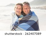 happy couple wrapped up in... | Shutterstock . vector #262407089
